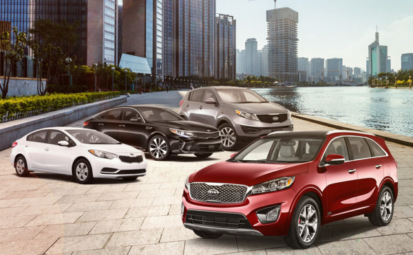 Custom-made image of four Kia models parked near each other against a city skyline