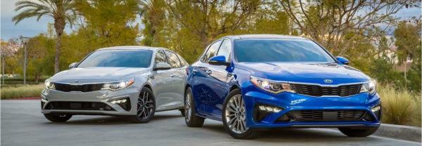 White 2019 Kia Optima and Blue 2019 Kia Optima side by side