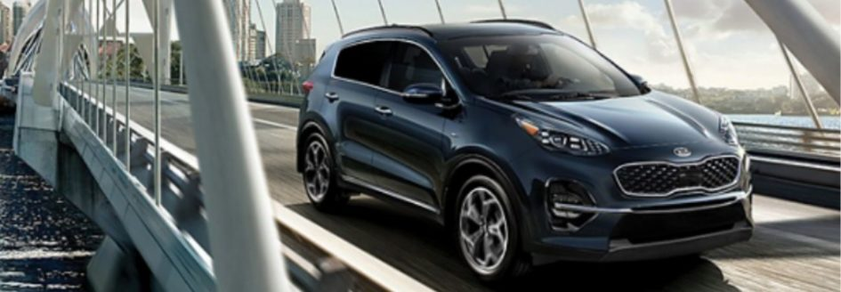 2020 kia sportage driving over a bridge